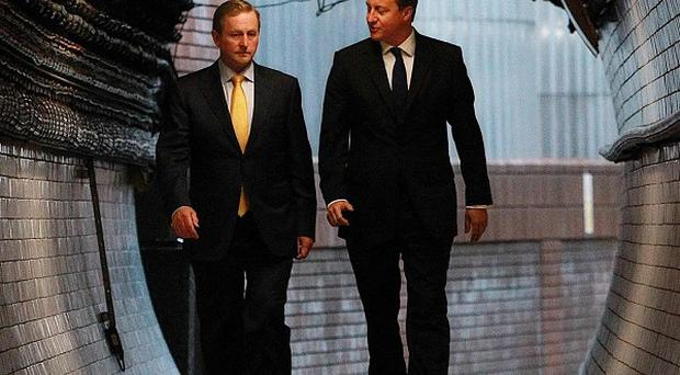 Taoiseach Enda Kenny (left) and Prime Minister David Cameron walk through a service tunnel at the Guinness Brewery in Dublin