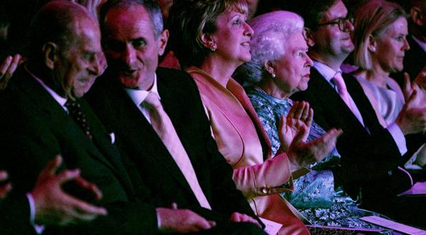 The Queen enjoying a fashion show as she attends the National Convention Centre Dublin on May 19, 2011 in Dublin, Ireland.