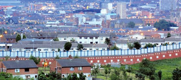 The peace wall dividing Catholic and Protestant west Belfast