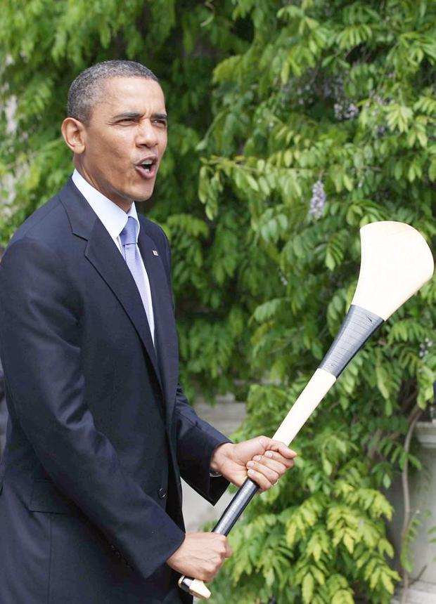 US President Barack Obama is presented with a hurley from Taoiseach Enda Kenny in Farmleigh, Dublin