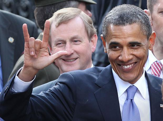 US President Barack Obama gestures after speaking in College Green as Irish Prime Minister Enda Kenny looks on on May 23, 2011 in Dublin, Ireland
