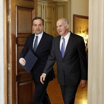 Greek prime minister George Papandreou, right, with opposition leader Antonis Samaras(AP)