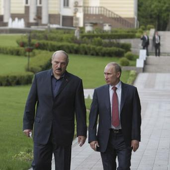 Russian prime minister Vladimir Putin, right, with Belarus' president Alexander Lukashenko, Belarus is anxious for Russian help with its economy (AP)