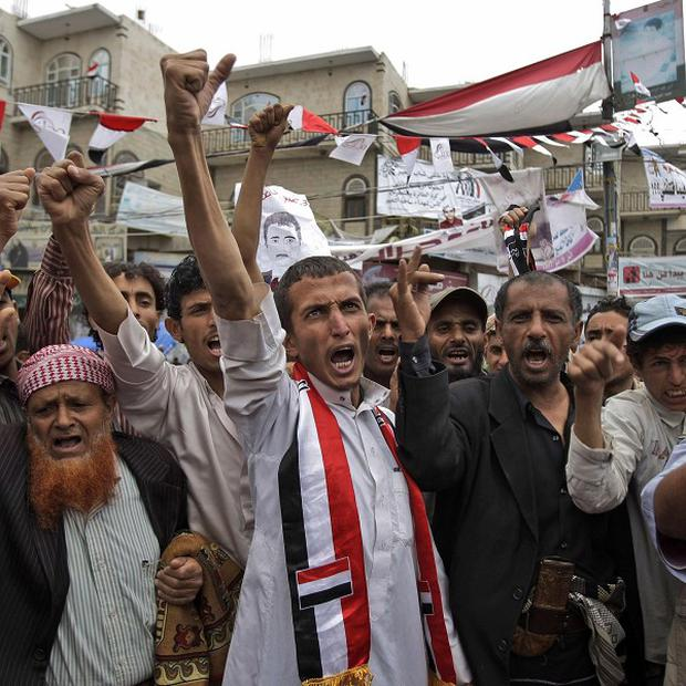 Anti-government protesters shout during a demonstration demanding the resignation of Yemeni president Ali Abdullah Saleh in Sanaa (AP)