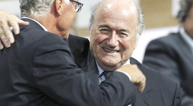 Fifa president Sepp Blatter is hugged by German soccer legend Franz Beckenbauer after his re-election (AP)