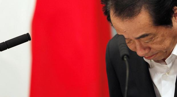 Japanese Prime Minister Naoto Kan has survived a vote of no-confidence