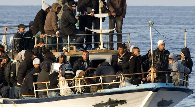 Overloaded boats carrying migrants regularly attempt to cross the Mediterranean, often with dire consequences (AP)