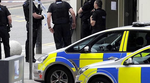 Police in Watford where they arrested a man who calimed to be carrying a bomb, after a three-hour stand-off at a bank