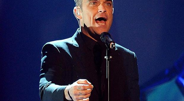 Robbie Williams has embarked on a new tour with Take That