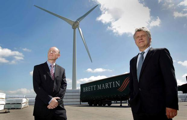 Laurence Martin (right), managing director at Brett Martin and Harry McGrath, production director, with the new wind turbine