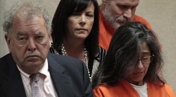 Nancy Garrido and her husband Phillip, in orange, with their lawyers at a sentencing hearing (AP Photo/Rich Pedroncelli, pool)