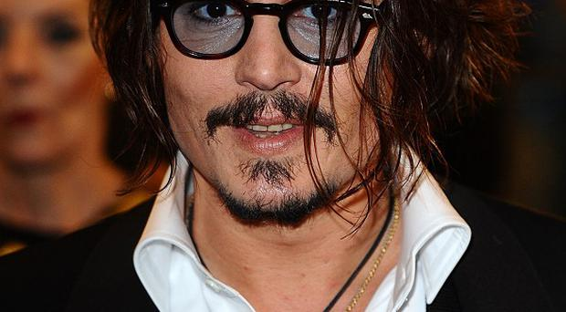 Johnny Depp stars as Captain Jack Sparrow