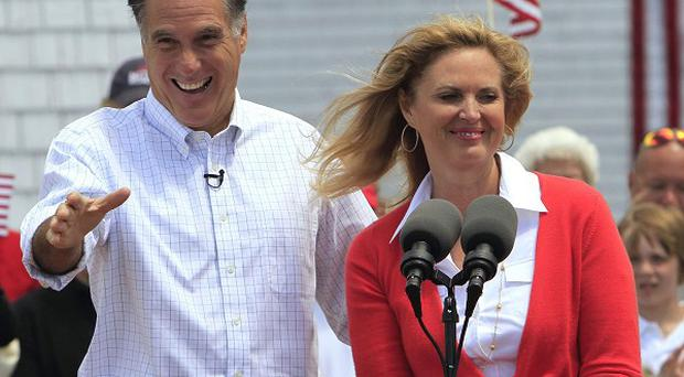 Mitt Romney, accompanied by his wife Ann, arrives to announce his 2012 US presidential candidacy (AP)