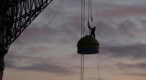 Greenpeace activists outside an Arctic survival pod attached to the underside of the 53,000-tonne Leiv Eiriksson oil rig