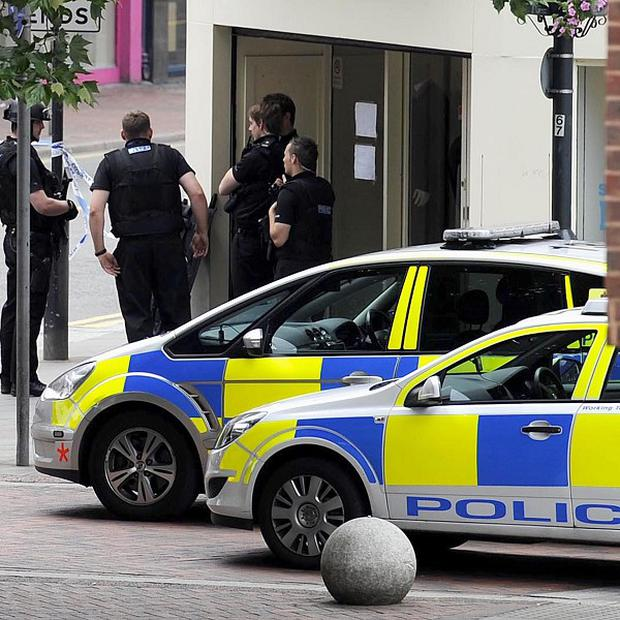 Police at the scene of a three-hour siege at a Co-operative bank in Watford
