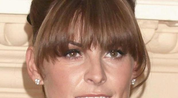 Three people are to appear in court over an alleged plot to blackmail Coleen Rooney