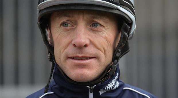 Kieren Fallon faces a wait for a court's decision on whether he can ride in Saturday's Derby at Epsom