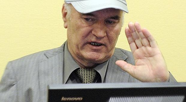 Former Bosnian Serb General Ratko Mladic salutes in the courtroom during his initial appearance at the UN's Yugoslav war crimes tribunal (AP)