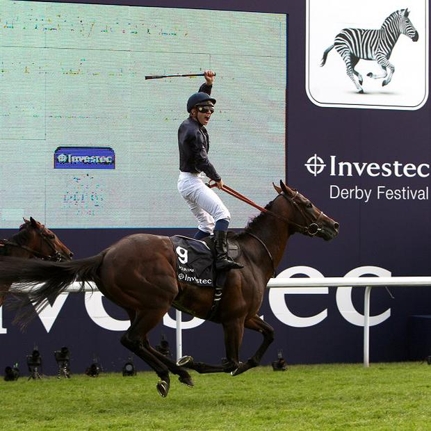 Mickael Barzalona celebrates riding Pour Moi to victory in The Investec Derby