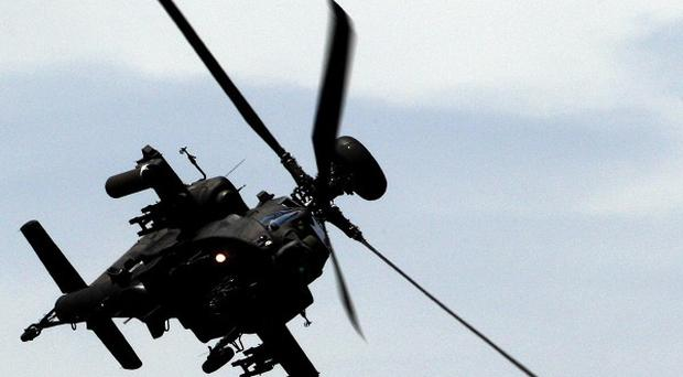 Apache helicopters hit two targets near the Libyan town of Brega