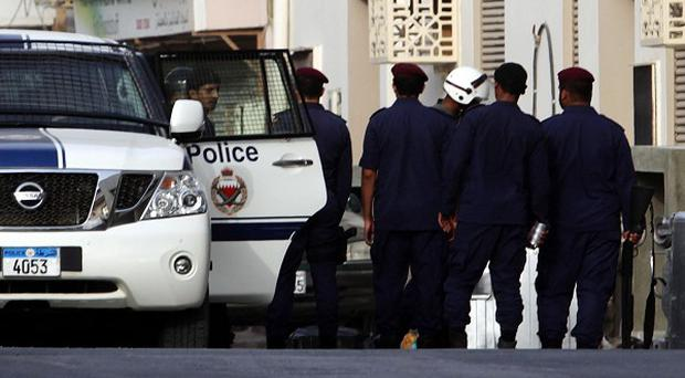 Police move in to the Shiite Muslim neighborhood of Sanabis in Manama, Bahrain (AP)