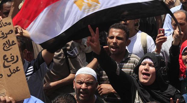 A former Egyptian finance minister has been sentenced to 30 years in absentia for squandering public funding