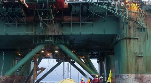 Greenpeace members climbed a 53,000-ton oil rig in the Arctic waters off Greenland
