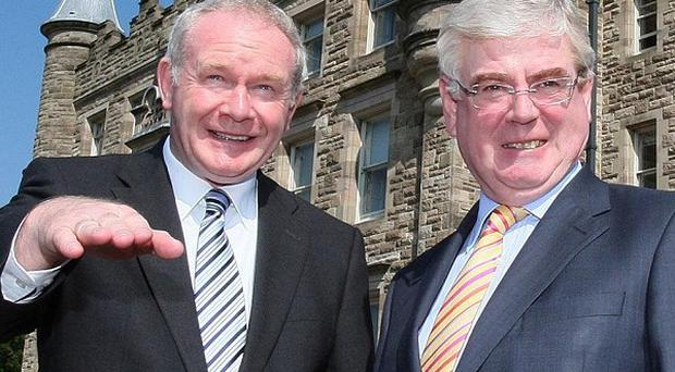 Deputy First Minister Martin McGuinness (left) meets Tanaiste Eamon Gilmore at Stormont Castle