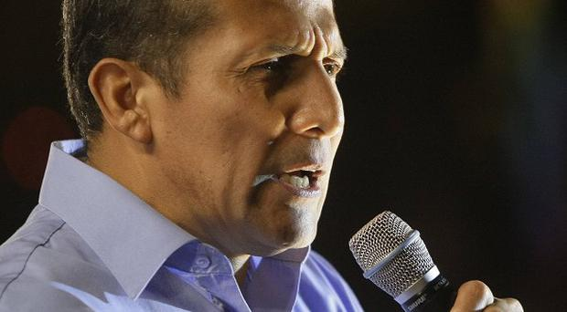 Presidential candidate Ollanta Humala speaks to supporters after the presidential runoff election in Lima, Peru (AP)