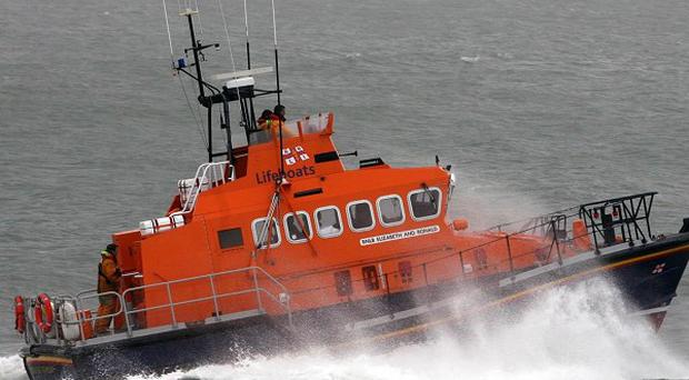 The Bangor lifeboat has rescued a man after his boat drifted towards rocks in Belfast Lough