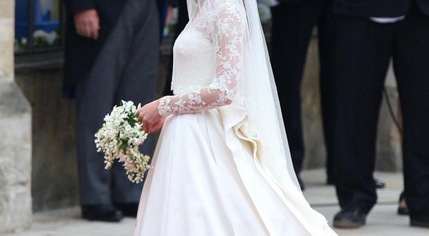 The Duchess of Cambridge's wedding dress is to go on display at Buckingham Palace