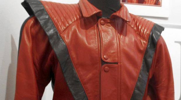 The worn and signed 'Thriller' Jacket that belonged to Michael Jackson which is going up for auction (AP)