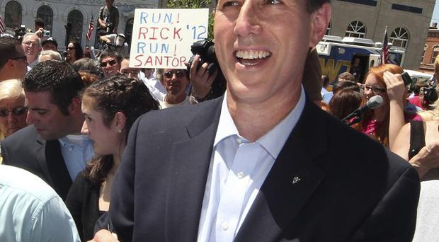 Rick Santorum works the crowd after announcing he is entering the Republican presidential race (AP)