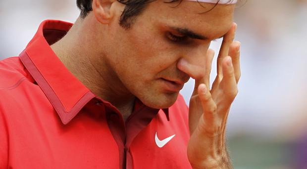 PARIS, FRANCE - JUNE 05: Roger Federer of Switzerland reacts during the menÄôs singles final match between Rafael Nadal of Spain and Roger Federer of Switzerland on day fifteen of the French Open at Roland Garros on June 5, 2011 in Paris, France. (Photo by Matthew Stockman/Getty Images)