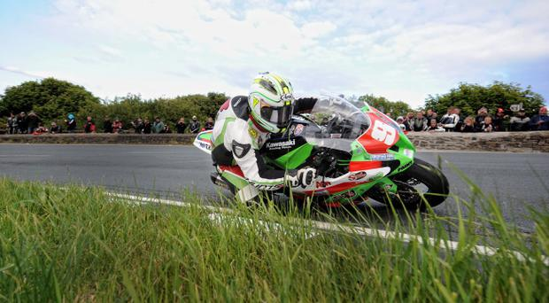 Michael Dunlop rides to victory in the Superstock TT race