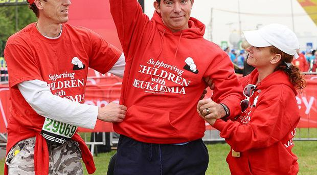 Former stunt rider Eddie Kidd has completed the London Marathon nearly two months after setting out on it