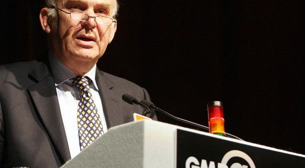 Vince Cable was heckled by trade union activists during a conference in Brighton