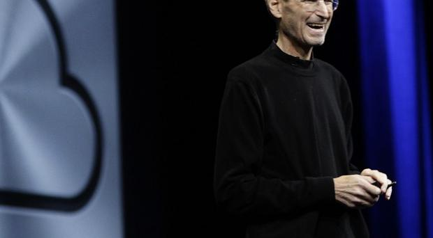 Apple CEO Steve Jobs introduces iCloud during a keynote address to the Apple Worldwide Developers' Conference (AP)