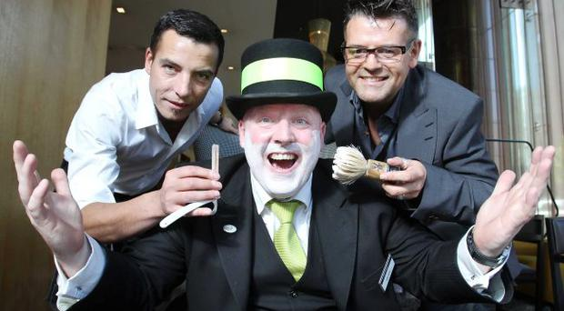 Jason Shankey and Stephen Mageean from Cruise with Concierge Gerard McCavanagh from the Fitzwilliam Hotel Belfast
