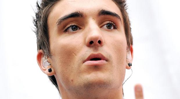 Tom Parker of The Wanted was involved in a 'tussle' with a former government figure at a charity football contest