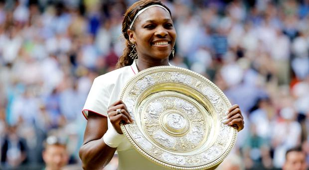 Serena Williams of USA lifts the Championship trophy after winning her Ladies Singles Final Match against Vera Zvonareva of Russia on Day Twelve of the 2010 Wimbledon Lawn Tennis Championships