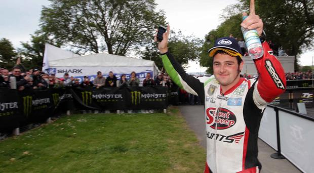 Michael Dunlop celebrates his Superstock win on Monday and is hoping to repeat his success in the Supersport race today