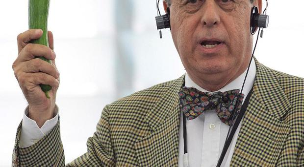 Spanish MEP Francisco Sosa Wagner holds up a cucumber during a debate on outbreak of E.coli(AP)