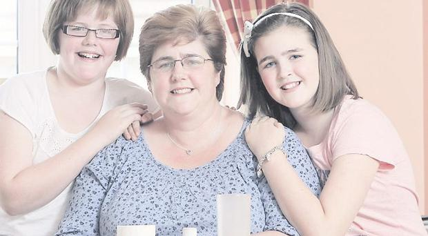Happy together: Cheryl Hall and her daughters Leah and Rebecca