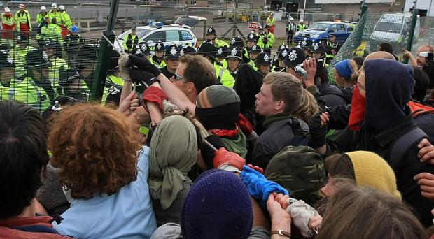 Cimate change protesters confront police near Ratcliffe-on-Soar power station