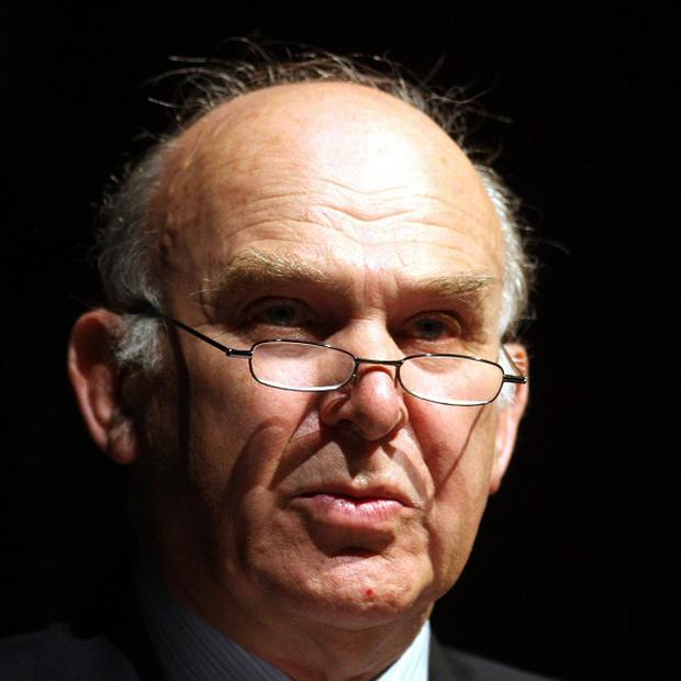 Business Secretary Vince Cable says the Government will raise taxes on banks if they fail to back small businesses