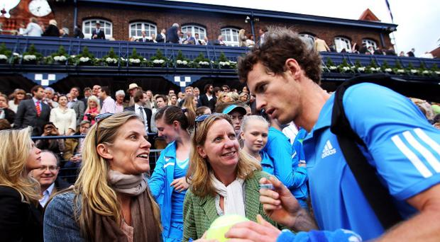LONDON, ENGLAND - JUNE 08: Andy Murray of Great Britain signs autographs in the crowd after winning his Men's Singles second round match against Xavier Malisse of Belgium on day three of the AEGON Championships at Queens Club on June 8, 2011 in London, England. (Photo by Julian Finney/Getty Images)
