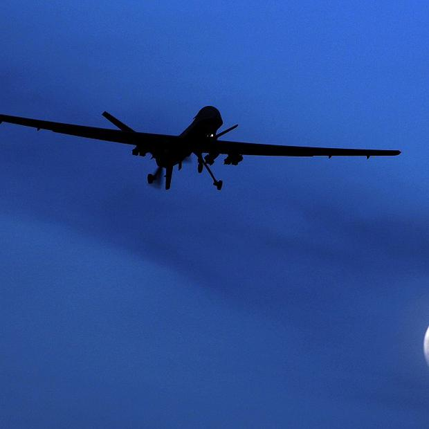 US Predator drones carry out missile strikes on militants on the Afghan border with Pakistan(AP)