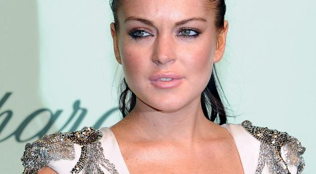 Lindsay Lohan is currently under house arrest in Los Angeles