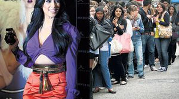 Kim Kardashian in London yesterday, where hundreds queued to meet the US TV star
